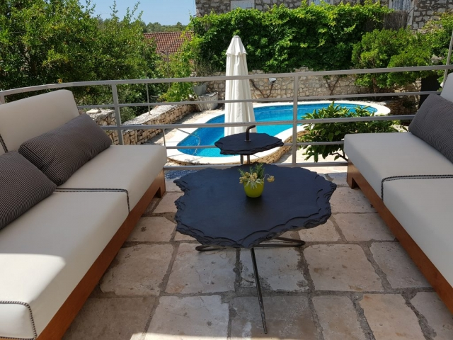 Shaded garden furniture with the swimming pool view
