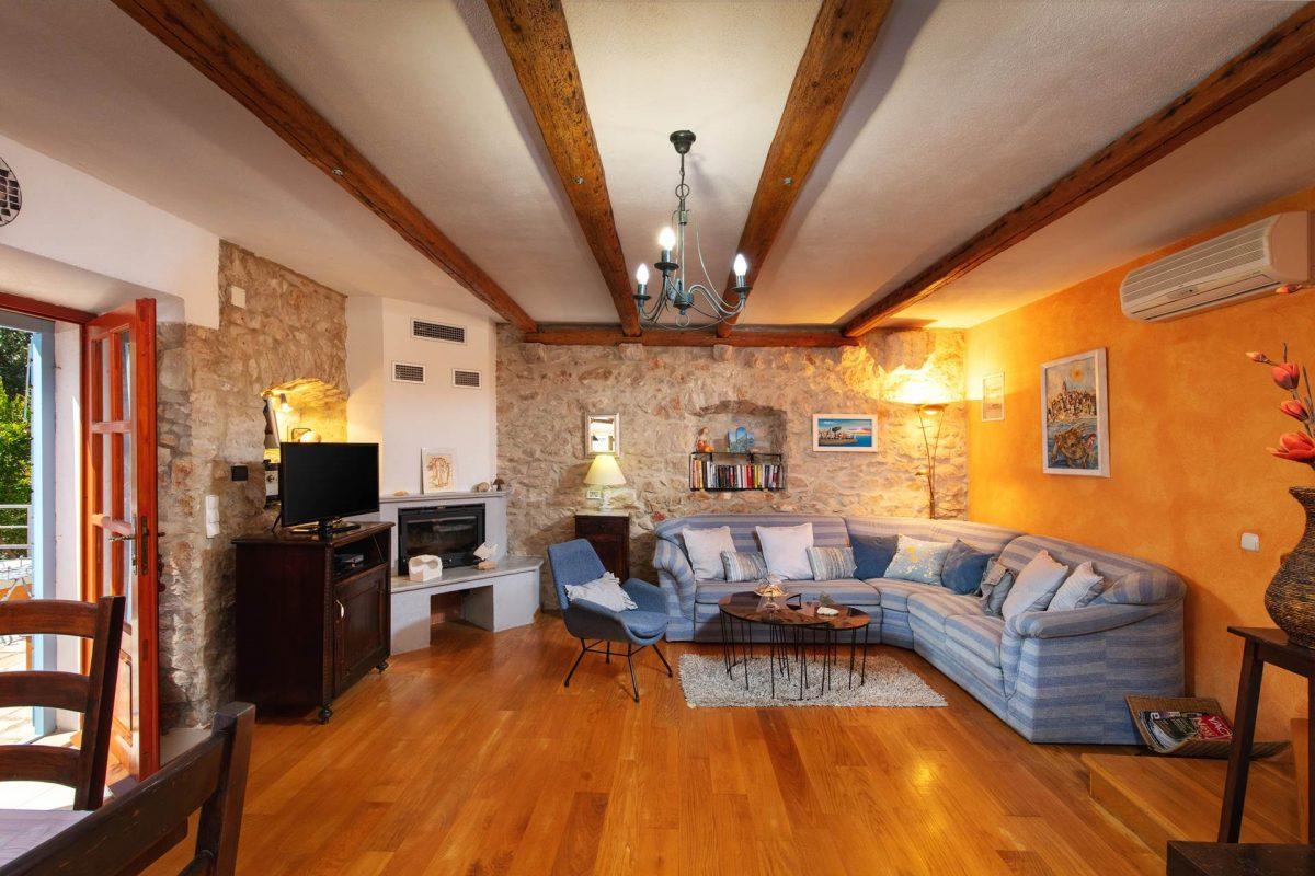 Airconditioned living room with lovely French doors and oak-beamed ceilings