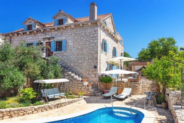 Sunlit Villa Vicina with beautiful greenery, private swimming pool, bed chairs and parasol