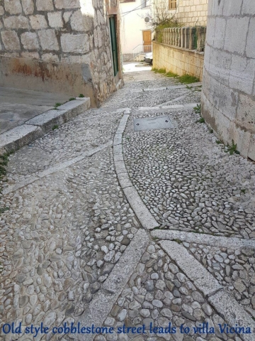 Old style cobblestone street leading to Villa Vicina