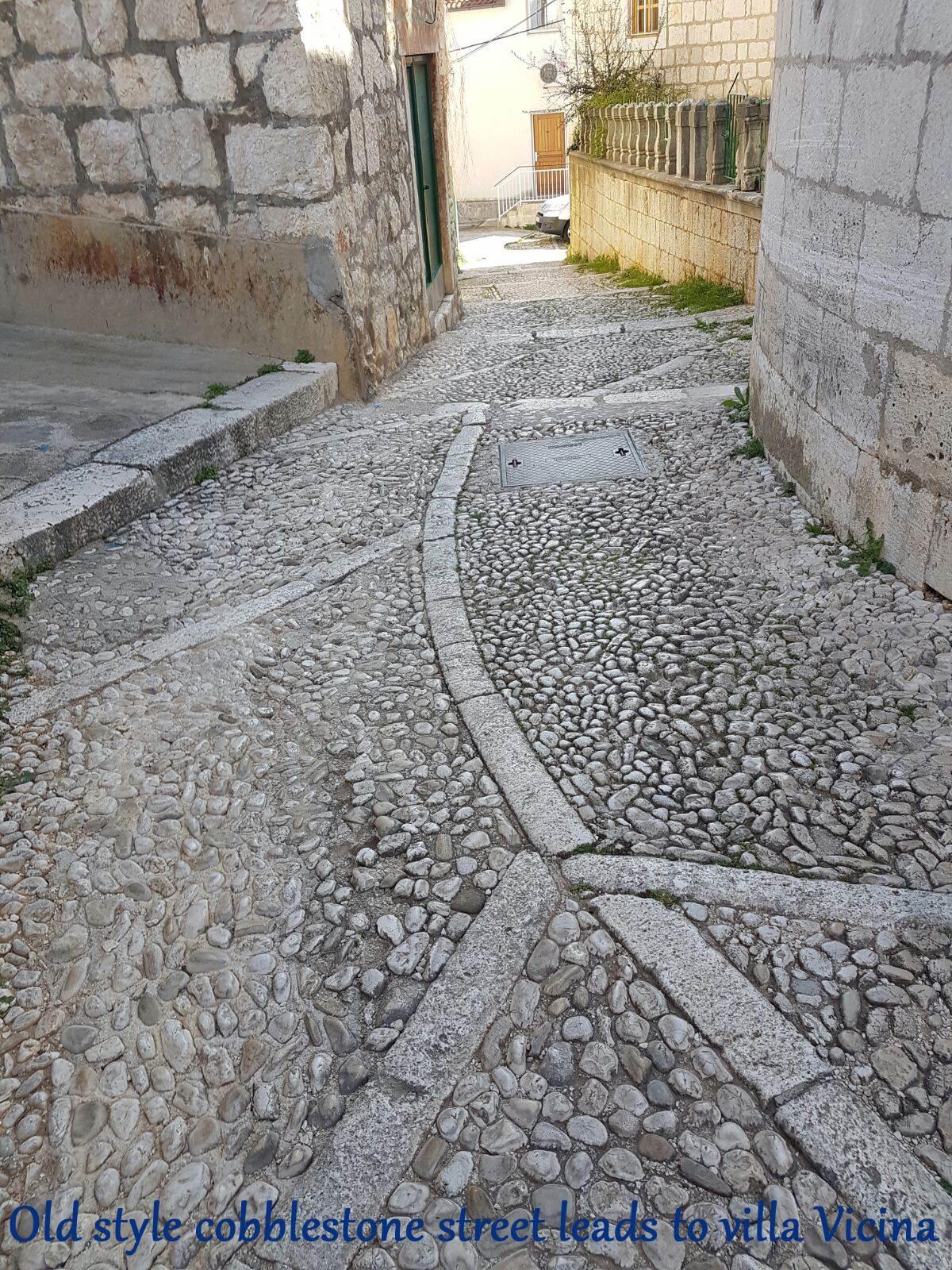 Old style cobblestone street leading to Villa Vicina